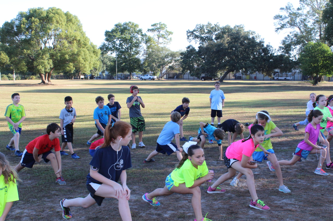 Students stretch before big run