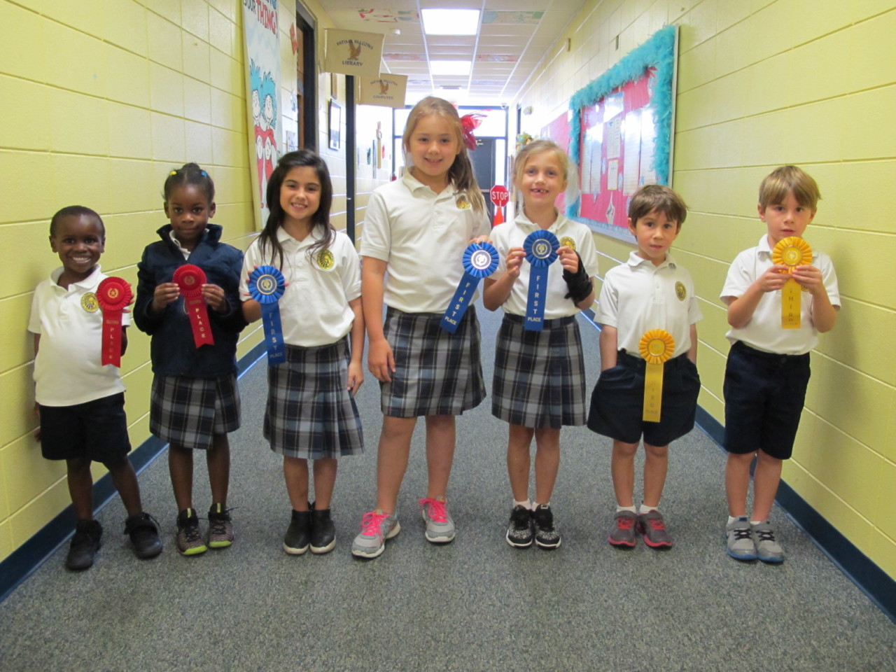 DJ Jones, Amani Jones, Bella Spinner, Elizabeth Mustered, Emerson Yelverton, Noah Jarecke, and Mathis Jarecke hold their ribbons from the Reading Fair